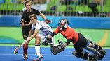 Матч группового тура в хоккее на трава между Канадой и Германией