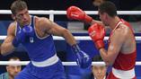 Боксер Евгений Тищенко (справа) выиграл очередной бой Олимпиады у двукратного чемпиона мира Клементе Руссо