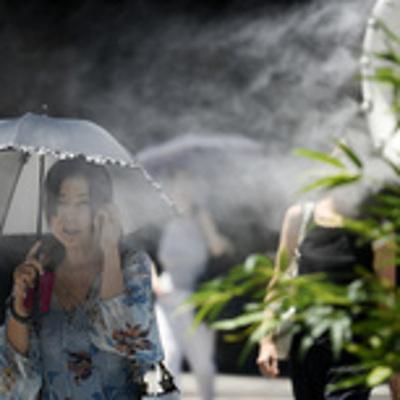 Жители Японии страдают от изнурительной жары