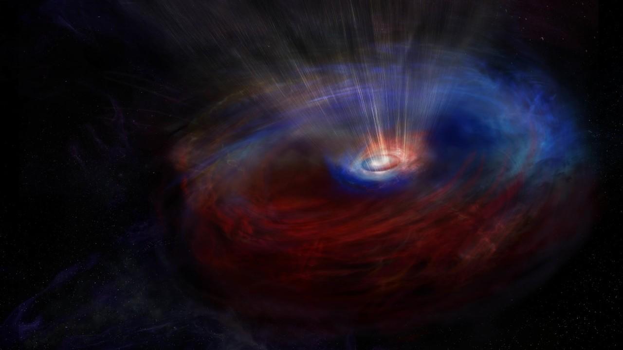 Два кольца вокруг гигантской чёрной дыры вращаются в противоположных направлениях