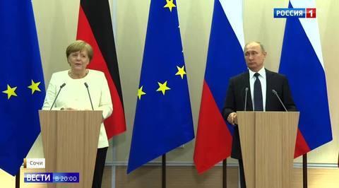 Теплая атмосфера и белый букет: о чем разговаривали Путин и Меркель