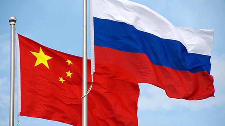 США провоцируют сближение России и Китая, пишет NI
