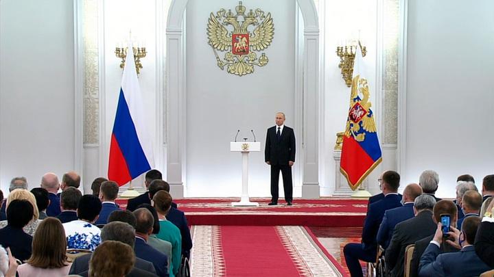 Путин: Госдума VII созыва приняла более сотни законов по поддержке материнства и детства